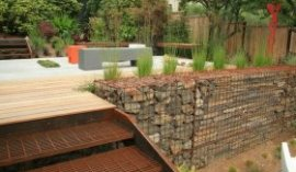 gabion retaining wall wooden deck metal stairs