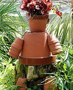Make your own garden art with terracotta pots and a plant.