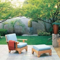outdoor patio with lounge chair and small patch of grass