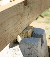 Tips and Ideas on How To Build a Floating Deck: Beam Laid Across Deck Block